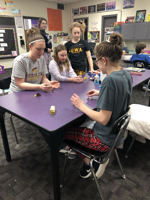 Mrs. Jungers was taught how to play Tenzi by 7th graders.