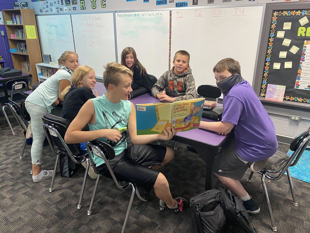 Students reading aloud to their peers